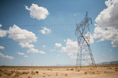 Electric power lines in desert Royalty Free Stock Photo