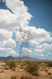 Electric power lines in desert Stock Photos