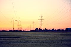 Electric power lines and pylon Stock Images