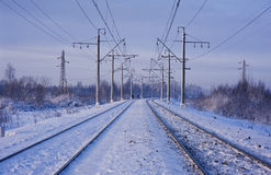 Electric power lines and railway tracks Royalty Free Stock Photos