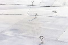 Electric power lines on snow aerial landscape Royalty Free Stock Photos