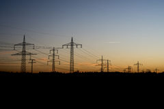 Electric power lines steel tower landscape sunset sunrise dawn silhouette 3 Royalty Free Stock Images