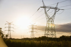 Electric power lines during summer Royalty Free Stock Photos