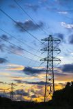 Electric power lines at sunset royalty free stock images
