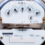 Electric power meter. Residential power supply meter with dials Royalty Free Stock Photo