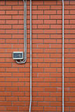 Electric power meter  on the brick wall Stock Images