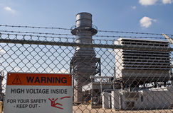 Electric Power Plant. Electrical power station with warning sign of the danger of high voltage Stock Photo