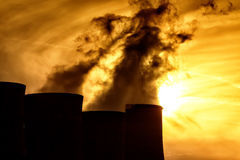 Electric power plant at dusk with orange sky in Kozani Greece.  Stock Images