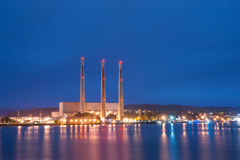 Electric Power Plant. Reflects lights onto the Pacific Ocean royalty free stock photos