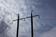 Electric power pole. With wires against the blue sky and clouds Royalty Free Stock Images