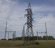 Electric power pole. With wires against the blue sky and clouds Royalty Free Stock Image