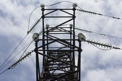 Electric power pole. With wires against the blue sky and clouds Royalty Free Stock Photography