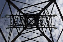 Electric power pole. With wires against the blue sky and clouds Stock Photos