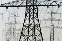 Electric power poles. Group of many electric power poles stock images