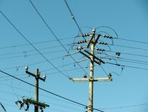 Electric power posts and overhead power lines  Royalty Free Stock Photo