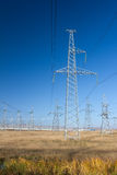 Electric Power Pylon, Power Lines. And Power Station on the background Stock Photo