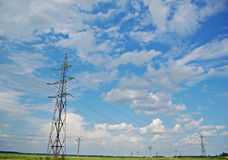 Electric power pylons. A field with electric power pylons stock image
