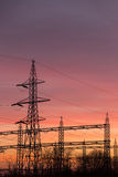 Electric power pylons sunset Stock Photo