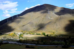 Electric power pylons on Tibetan mountains Stock Photography