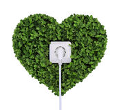 Electric power receptacle on a green grass background isolated o Royalty Free Stock Image