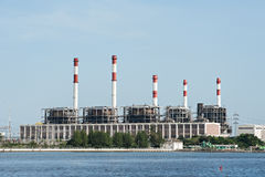 Electric power refinery plant. Nearby the river in Thailand stock photography
