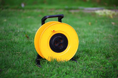 Electric power spool socket. On the grass Stock Image