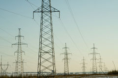 Electric power station lines, on the blue sky backing Royalty Free Stock Image
