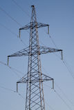 Electric power station lines, on the blue sky backing Royalty Free Stock Images