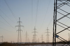 Electric power station lines, on the blue sky backing Stock Photos