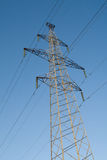 Electric power station lines, on the blue sky backing Royalty Free Stock Photography