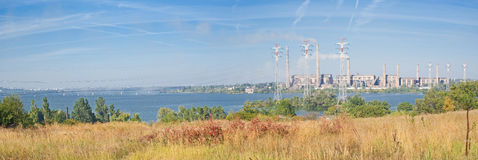 Electric power station beside a river. Royalty Free Stock Images