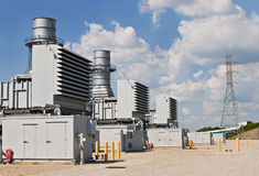 Electric Power Substation. Electrical power substation with tower in background Stock Image