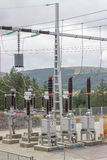 Electric Power Substation with circuit switcher, regulators and Royalty Free Stock Photos