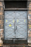 Electric power substation gate. Detailed texture of a metal gray electric power substation gate Royalty Free Stock Photo