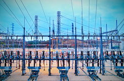 Electric power substation. Power station for making Electricity. Shot before sunrise with cable red hot Royalty Free Stock Image