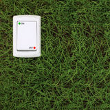 Electric power switch on a green grass background Stock Photos