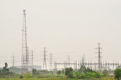 Electric power towers in countryside area Royalty Free Stock Photos