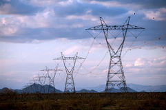 Electric Power Towers in Sunset Stock Photography