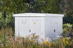 Electric power transformer in a meadow Royalty Free Stock Photos