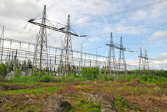 Electric power transmission lines. In summer landscape Stock Photos