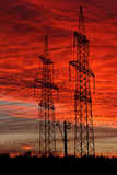 Electric power transmission lines at sunset. Royalty Free Stock Image