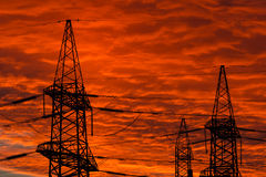 Electric power transmission lines at sunset. Stock Photography