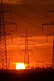 Electric power transmission lines at sunset. Royalty Free Stock Photography