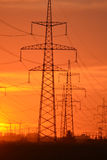 Electric power transmission lines at sunset. Royalty Free Stock Images