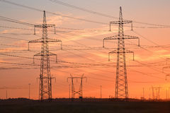 Electric power transmission lines at sunset. Royalty Free Stock Photos