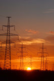 Electric power transmission lines at sunset. Stock Images