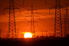 Electric power transmission lines at sunset. Stock Photo