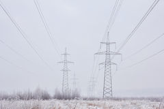 Electric power transmission lines in the winter. Royalty Free Stock Photography