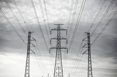 Electric power transmission or power grid pylon wires, transmission tower in Thailand Stock Photo
