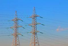Electric power transmission towers. At sunrise stock photos